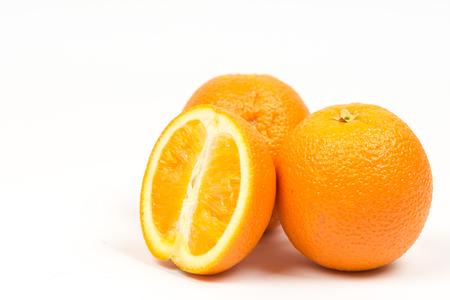 Three sliced oranges isolated over white background.