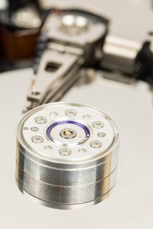 disco duro: Inside opened pc hard disc isolated over white background.
