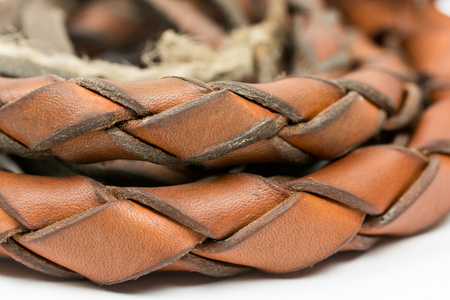 braided: Leather whip isolated over white background closeup macro.