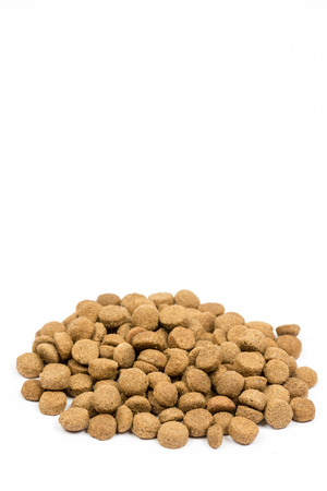 Dog and cat food granules isolated over white background.