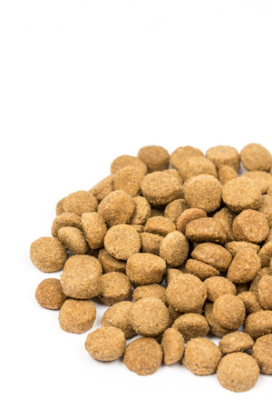 nutritional: Dog and cat food granules isolated over white background.