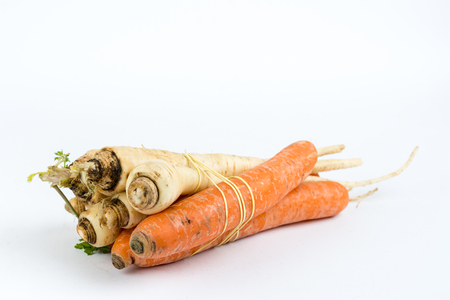 Carrots and parsnips isolated over white background.
