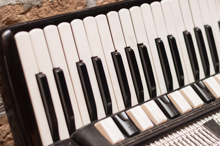 Accordion keyboard in the closeup image background