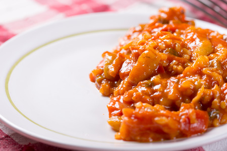 Thick tomato stew with rice and pepper. Stock Photo