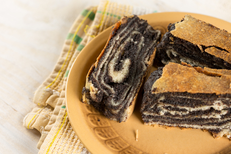 strudel: Poppy seed roll cake on the plate closeup macro. Stock Photo