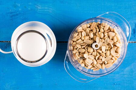 blender: Blanched peanuts in the blender in flat lay above blue wooden ba Stock Photo