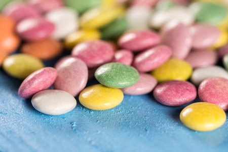 Closeup macro colorful round candies with blurred background Stock Photo