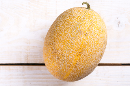 Fresh melon on the wooden board table. Stock Photo