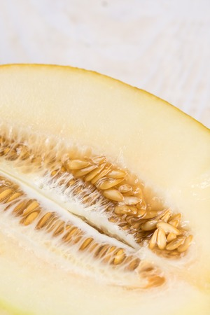 Closeup macro melon pits on the wooden board.
