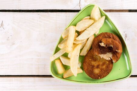 junk: Fried fish meat burgers served with french fries on the plate.