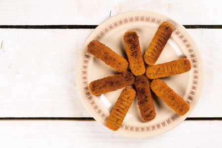 junk: Flat lay above fried fish meat sticks on the plate. Stock Photo
