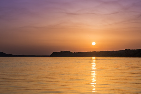 Beautiful unreal abstract colorful sunset on the Danube river