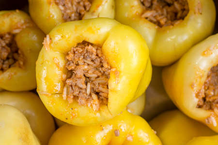 Yellow paprika stuffed with minced meat and ready for cooking. Stock Photo