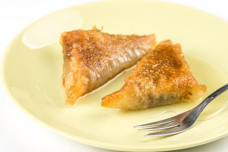 baklava: Baklava pie with walnuts on the plate.