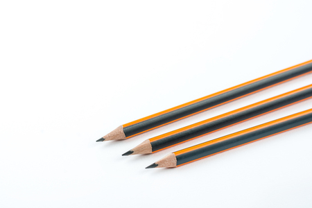 Graphite wooden pencils isolated over white background with copy space.