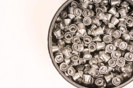 Metal pellets for air rifle gun in the box isolated above white background.