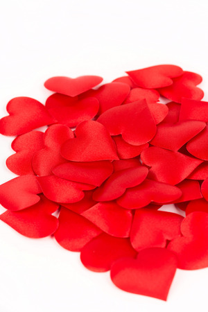Pile of red hearts isolated above white background. Love and romantic red hearts background. Stok Fotoğraf - 88354614