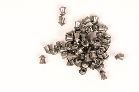 Pile of metal pellets for air gun isolated on white background. Stock Photo