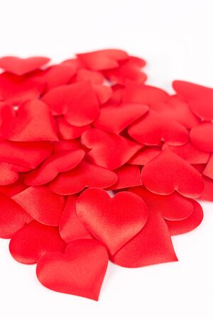 Pile of red hearts isolated above white background. Love and romantic red hearts background.