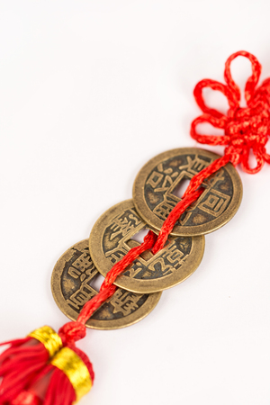 monete antiche: Three ancient Feng shui metal lucky coins isolated above white background. Archivio Fotografico