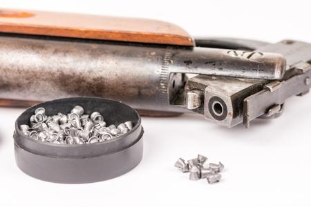 Box with metal air gun pellets and air gun with wooden kundak gunstock Stock Photo