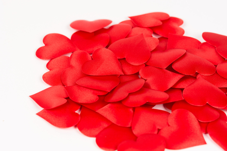 Pile of red hearts isolated above white background. Love and romantic red hearts background. Stok Fotoğraf - 88354911