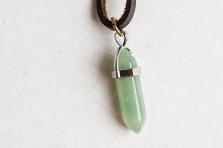 Lucky green aventurine semiprecious stones necklace isolated above white marble stone. Stock Photo