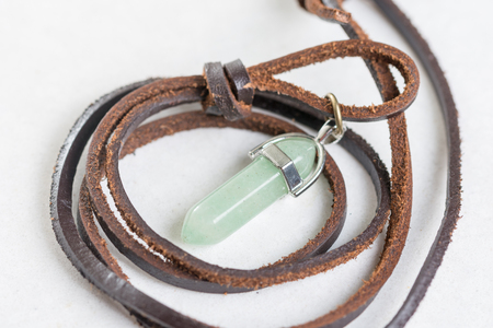 gemmology: Lucky green aventurine semiprecious stones necklace with leather cord.