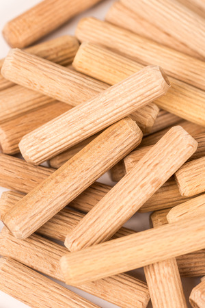 grooves: Pile of wooden dowels isolated on white background. Stock Photo
