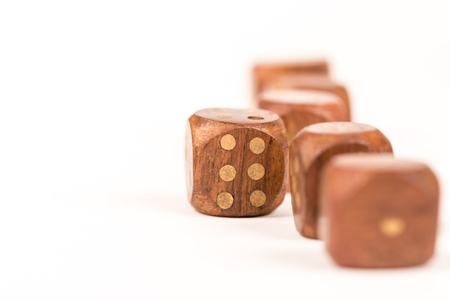 Selective focus on wooden gambling dice with individuality concept.