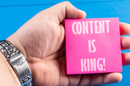 Content Is King Concept Text On The Sticky Paper Notes In The Hand.