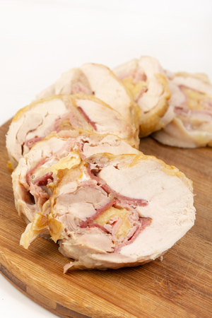 Rolled Baked Chicken Meat With Cheese And Ham. Imagens