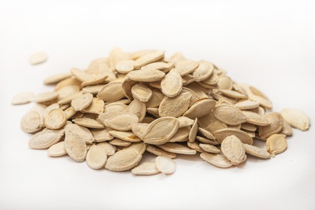 Dried pumpkin seeds isolated above white background Stok Fotoğraf