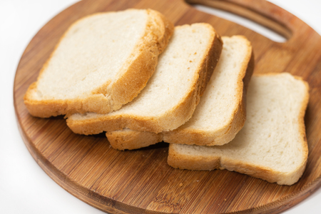 White bread toast slices on the wooden cutting board Stok Fotoğraf