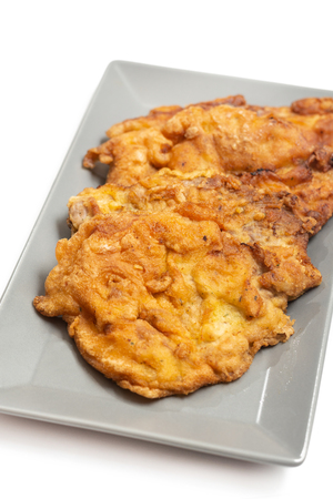 Fried pork meat served on the plate.