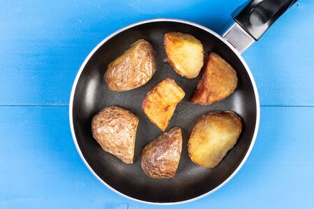 Fried young potaotes in the frying pan.