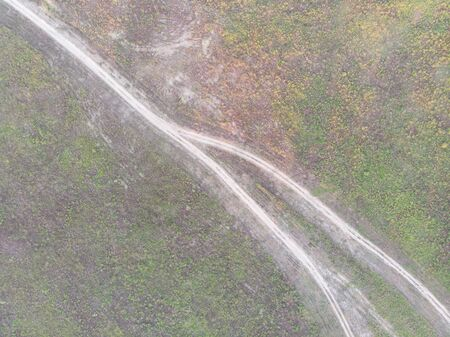Aerial image of paved road in the green fields 版權商用圖片