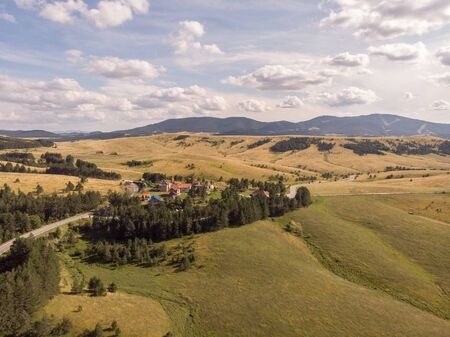 Aerial image of Zlatibor mountain in Serbia. Beautiful landscape image with yellow fields and blue sky