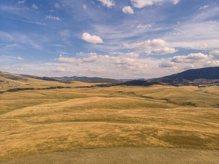 Aerial image of Zlatibor mountain in Serbia. Beautiful landscape image with yellow fields and blue sky Reklamní fotografie - 128830633