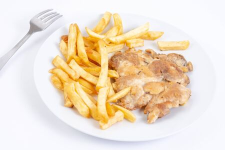 Grilled chicken drumstick served with french fries. Stock Photo - 128830631