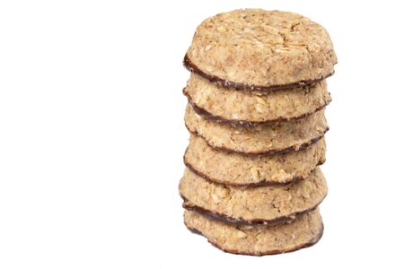 Pile of round chocolate biscuits on the white background. Zdjęcie Seryjne
