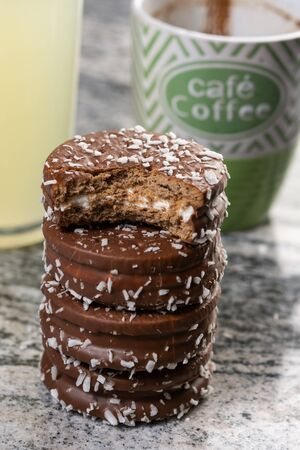 Chocolate cookies with coconut on the grey marble table.
