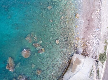 Birds eye view from drone at adriatic sea beach.