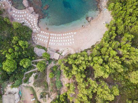Beautiful aerial birds eye view of sea beach with sunbeds.