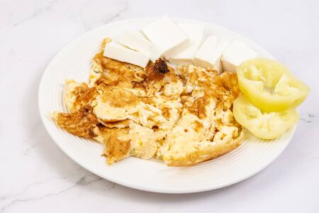 Fried eggs served with white cheese and sliced paprika. Healthy food concept with eggs and vegetables