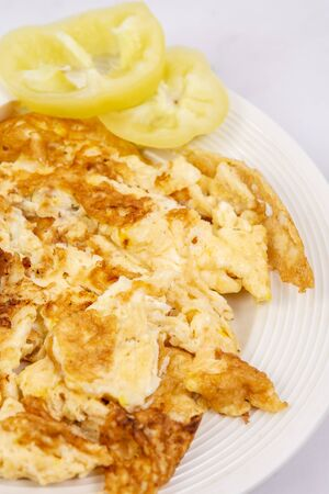 Fried eggs served with white cheese and sliced paprika. Healthy food concept with eggs and vegetables. Zdjęcie Seryjne