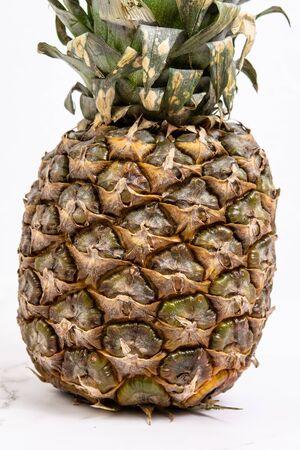 Fresh whole Pineapple isolated above white background.