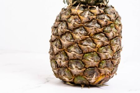 Fresh whole Pineapple isolated above white background.