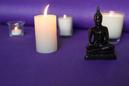 Candles and buddha in relaxation space