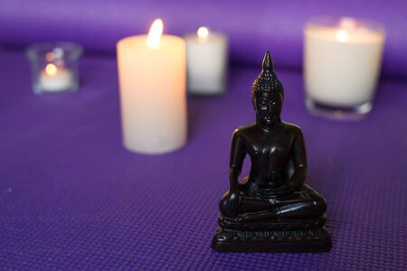 Candles and buddha in relaxation space Stock Photo